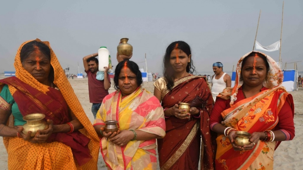 Women perform rituals at Ganga river during 'Kharna' on the occasion of Chhath Puja in Patna