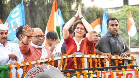 Congress general secretary (eastern UP) Priyanka Gandhi Vadra and party's candidate from Varanasi Ajay Rai (second from left) during a roadshow in Varanasi on Wednesday