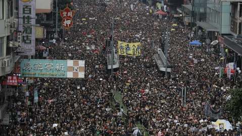 Lakhs of protesters march through the streets of Hong Kong  as they continue to protest an extradition bill, on June 16, 2019.