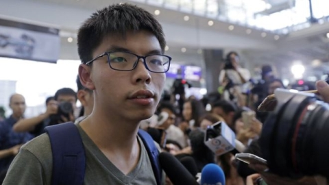 Hong Kong activist Joshua Wong walks free, calls on leader to resign