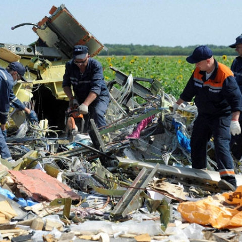 Investigators sift through the  debris of MH17 that was shot down in Ukrainian airspace on July 17, 2014 .