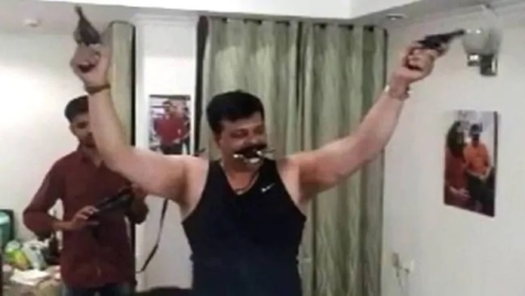 WATCH|  BJP MLA dances to Karan Arjun songs with guns in hand