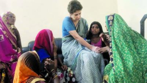 Priyanka Gandhi with the families of Sonbhadra carnage victims (file photo).