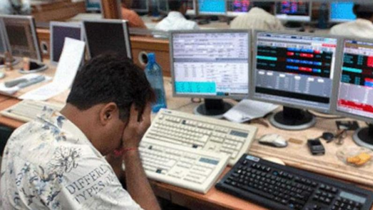 A stock broker mourns as the market crashes (PTI file photo).