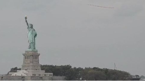 Aircraft circles Statue of Liberty carrying message 'UN must help end human rights abuses in Balochistan'