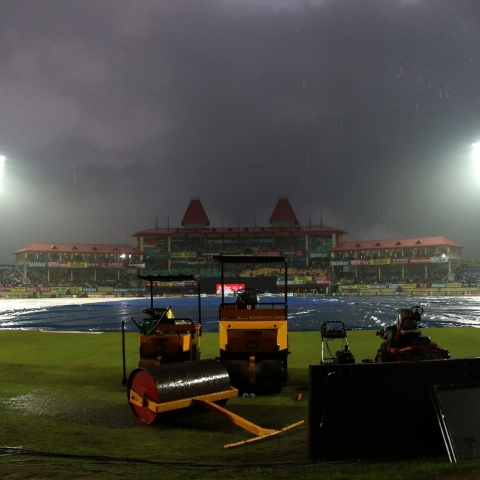 A view of the pitch at Dharamsala cricket stadium covered with plastic sheets during rains ahead of the first T20I match between India and South Africa on Sep 15, 2019. (Photo: Surjeet Yadav/IANS)