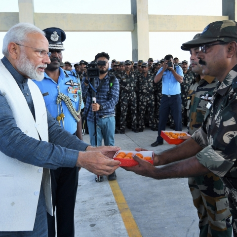PM Modi distributing laddu to soldiers in Rajouri, Jammu and Kashmir on Diwali day, October 27, 2019 (Photo courtesy: PIB)