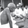 Gandhi with people from Harijan community