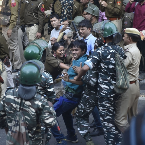 Police stopping JNU students from crossing the barricades during a protest march towards Parliament in New Delhi, Monday, Nov 18, 2019. (PTI photo)
