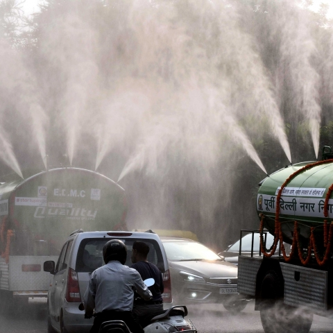East Delhi Municipal Corporation (EDMC) tankers sprinkle water on a street as a measure to curb pollution in New Delhi (IANS)