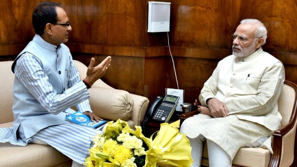 पीएम नरेंद्र मोदी और शिवराज सिंह चौहान