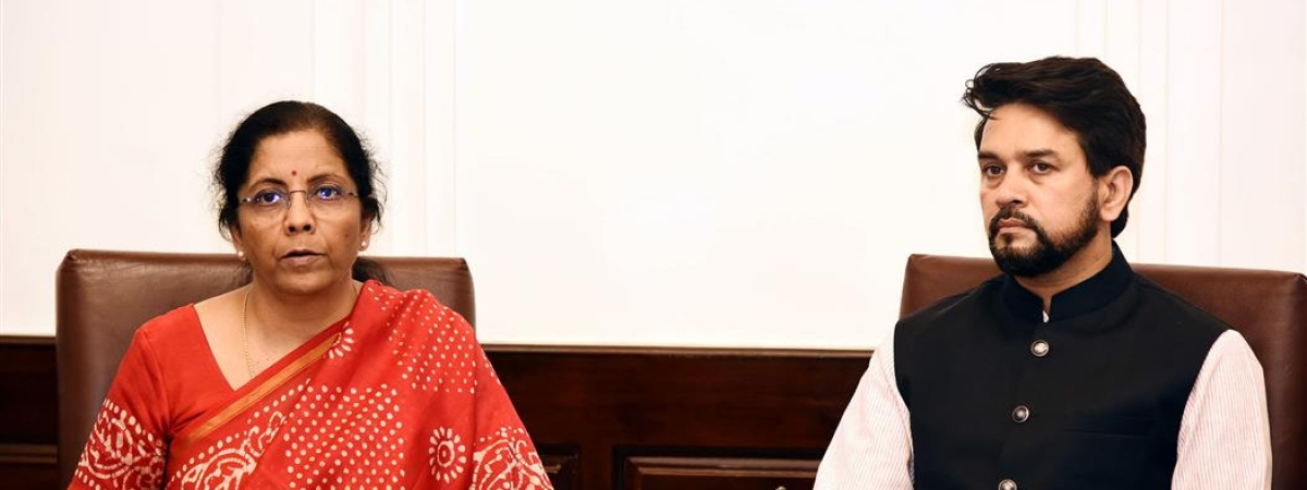 Finance Minister Nirmala Sitharaman and Minister of State for Finance Anurag Singh Thakur addressing a press conference, through video-conferencing, in New Delhi on March 24, 2020.