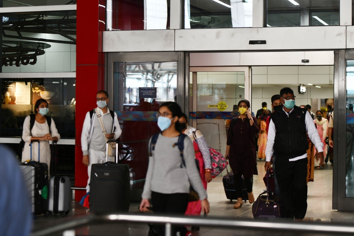 Passengers seen wearing masks as a precautionary measure against coronavirus at the Indira Gandhi International Airport in New Delhi on March 15, 2020.