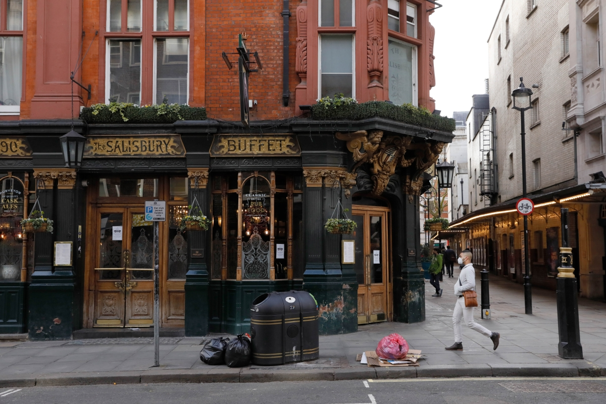 A man walks past a closed pub in Covent Garden in central London, Britain, on March 21, 2020.
