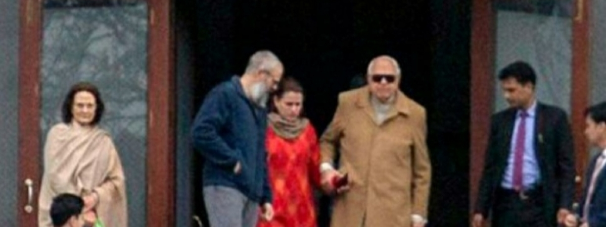 A day after his release, former Jammu and Kashmir Chief Minister Farooq Abdullah meets his son Omar Abdullah, who is detained at Hari Niwas in Srinagar, on March 14, 2020.