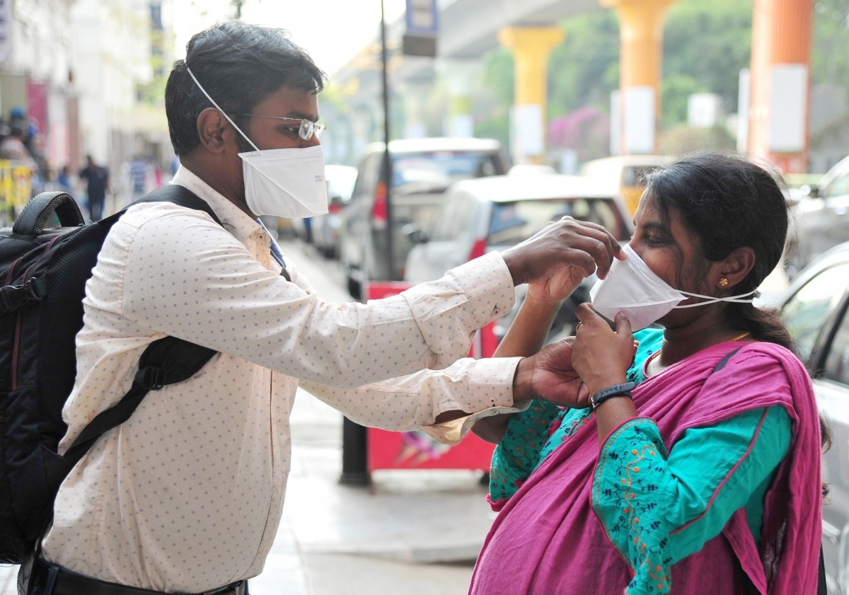 People wearing masks as a precautionary measure against coronavirus, in Bengaluru on March 5, 2020.