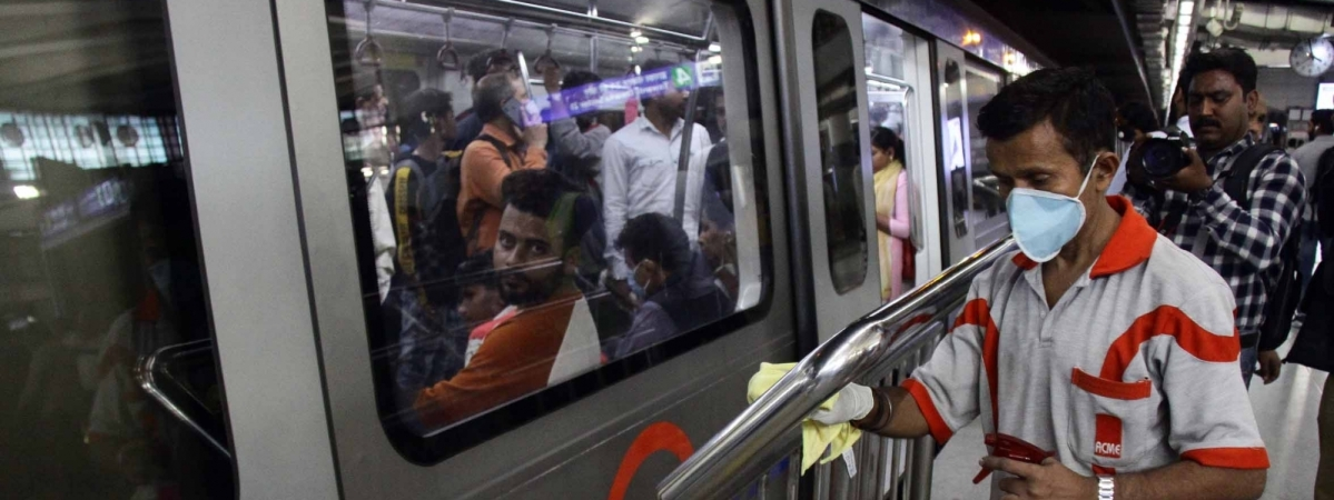 Staff sanitising a metro station during a cleaning drive launched by the Delhi Metro Rail Corporation against the coronavirus (COVID-19) in New Delhi, on March 13, 2020.