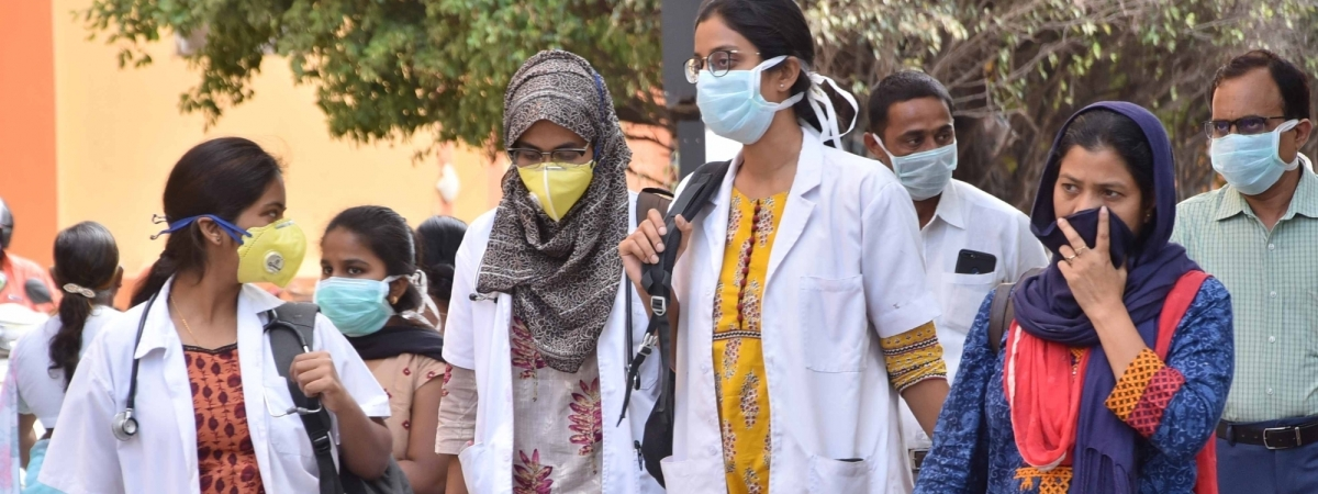 People seen wearing masks as a precautionary measure against coronavirus, in Hyderabad on March 4, 2020.