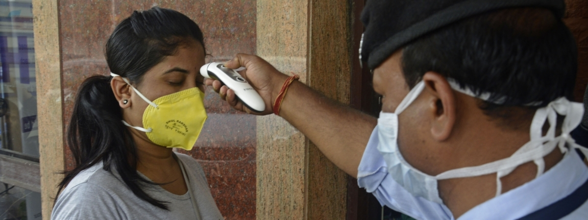 Thermal scanners being used to screen visitors for coronavirus at a private hospital in Kolkata, on March 16, 2020.