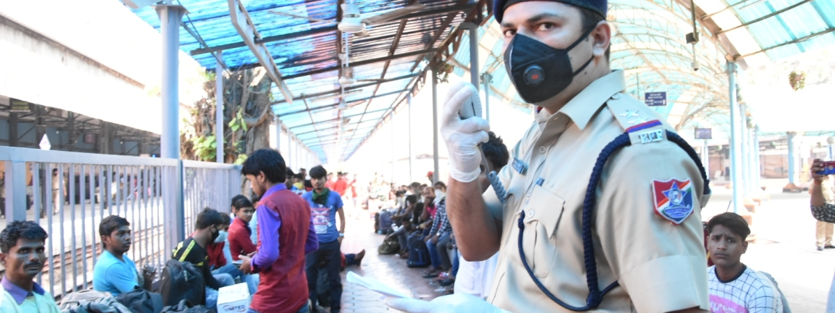 Migrant workers trying to return home to states like UP, Bihar, Odisha, Jharkhand and Chhattisgarh in view of the growing number of coronavirus (Covid-19) cases, and being guided by Railway Protection Force personnel at Chhatrapati Shivaji Maharaj Terminus, in Mumbai March 21, 2020.