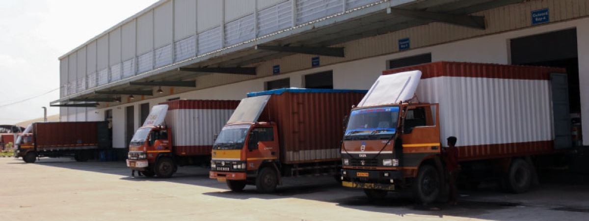 Trucks parked outside a Flipkart warehouse.