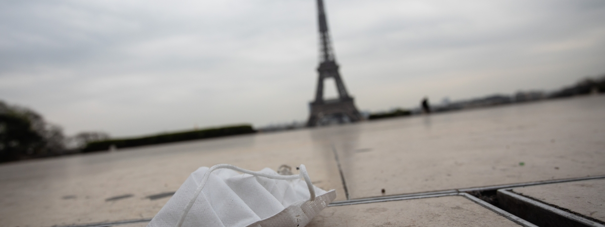 A face mask is seen on the ground near the Eiffel Tower in Paris, France, on March 17, 2020.