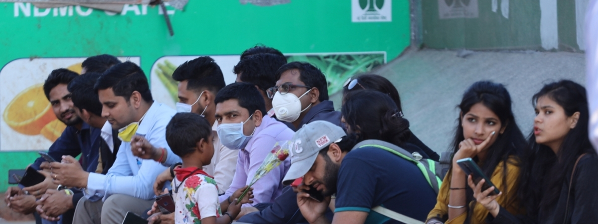 People seen wearing masks at Delhi's Connaught Place as a precaution against the coronavirus pandemic, on March 18, 2020.