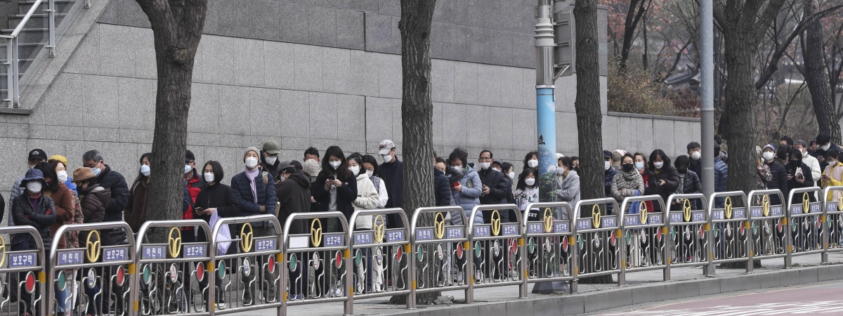 Locals line up to buy face masks in Seoul, South Korea, on March 1, 2020 as the number of confirmed coronavirus cases in the country continues to rise, on March 1, 2020.