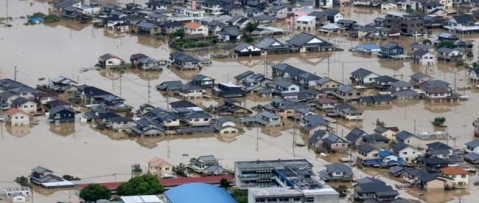 Japan floods kill nearly 100