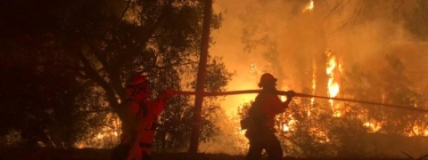 California wildfire spreads quickly; residents evacuate