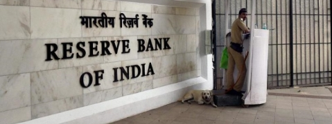 RBI keeps rates untouched, Re slides to record low