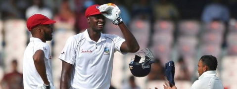 West Indies at 295/7 at stumps; half centuries for Chase and Holder