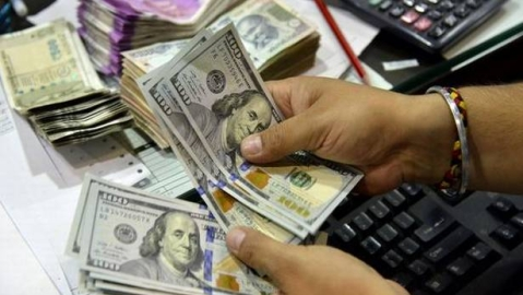Rupee down by 7 paise against USD