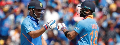 Virat, Dhoni half century take India to 268/7 against Windies