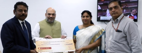 Amit Shah receives a dividend cheque from Repco Bank
