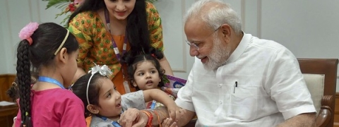PM celebrates Rakhi with children, women