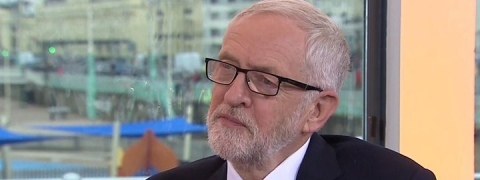 Labour party: Corbyn plays down divisions amid aide's exit