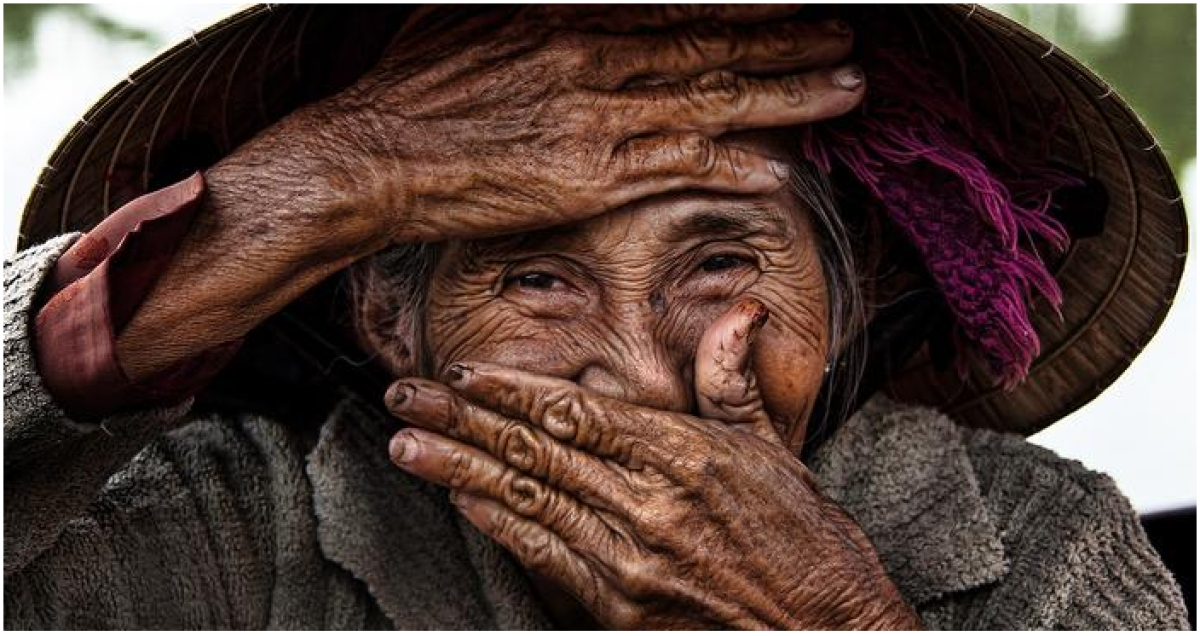 Hidden Smile – This photo has a lot of texture and detail. Since a major part of the face is covered the attention goes to the eyes of the woman which communicates the emotion she is feeling.