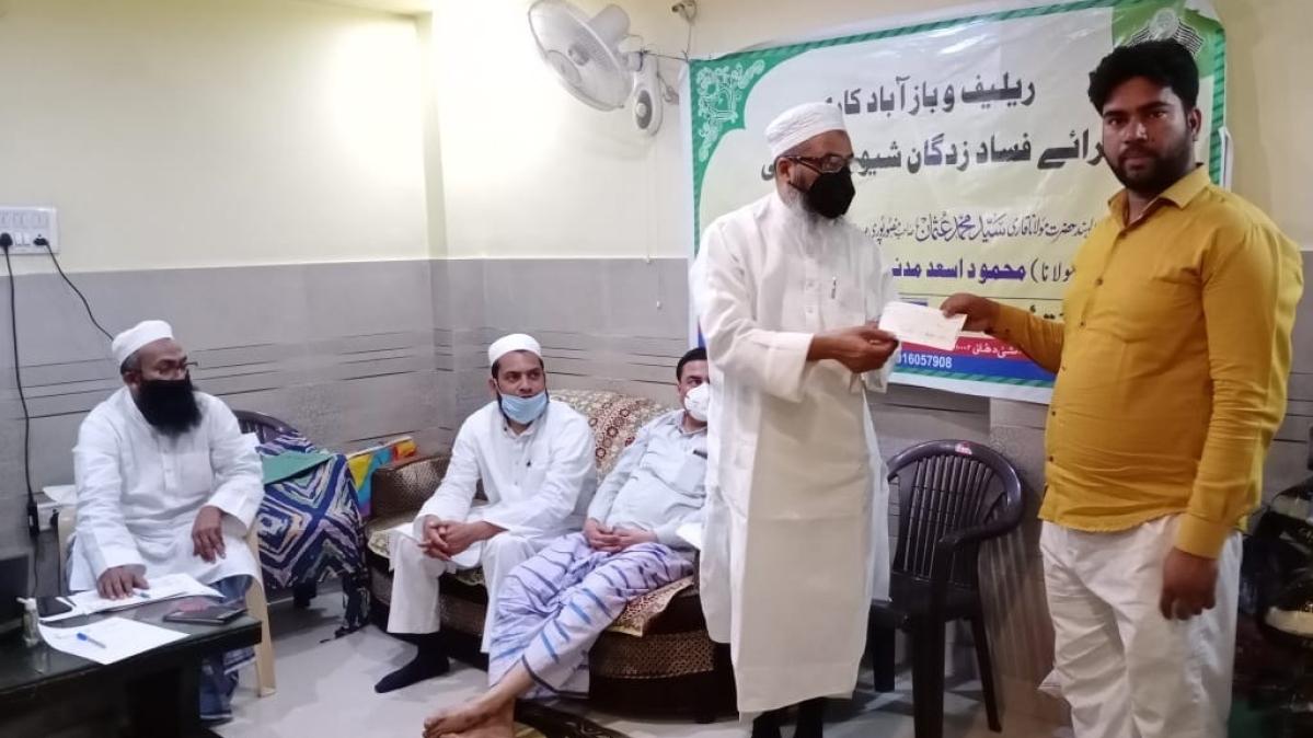 دہلی فساد: 64 چھوٹے تاجروں کی بازآبادکاری کے لیے جمعیۃ علماء ہند کی طرف سے چیک تقسیم