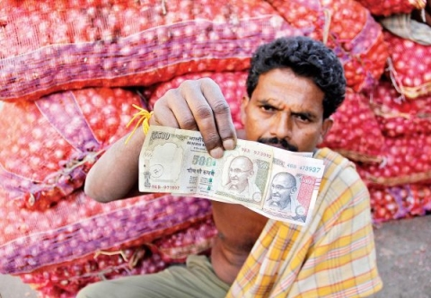 Pan mandatory hurting payments of daily wage labourers after Modi's demonetization
