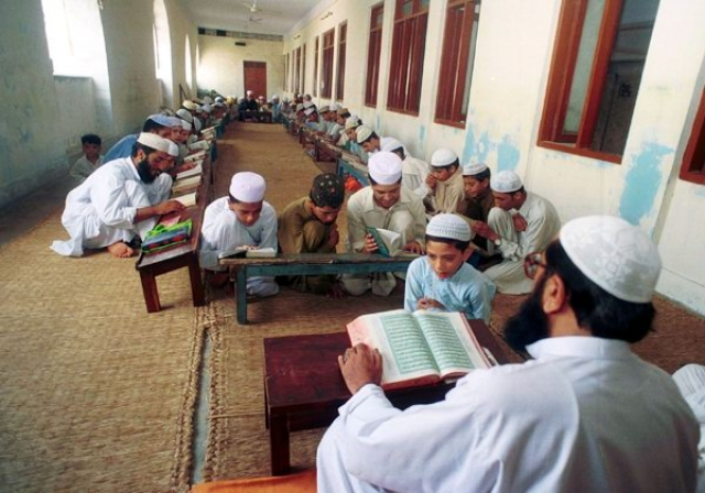 "Students recite line at a Madrasa in Pakistan. Photo Credit: <a href=""http://www.quazoo.com/q/Madrassas%20in%20Pakistan"" shape=""rect"">Quazoo</a>"