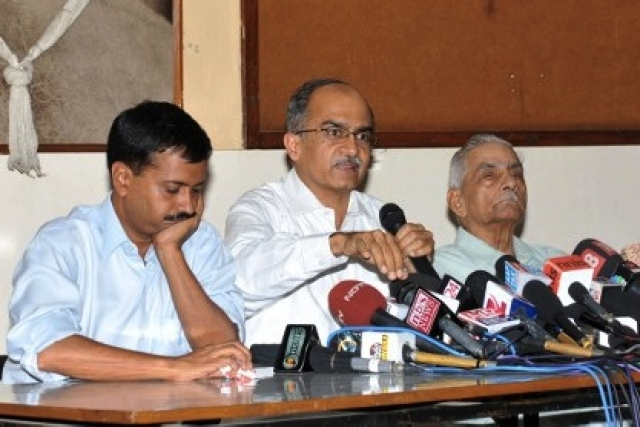 Kejriwal with Shanti and Prashant Bhushan. Source: AFP PHOTO / Sajjad HUSSAIN