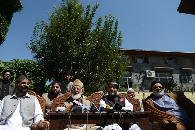 Senior seperatist leader Nayeem Khan (L), Kashmiri separatist leader  Syed Ali Shah Geelani (2L), Shabir Shah and Shia cleric Aga Syed Hassan  speak during a press conference .         (Photo credit-TAUSEEF MUSTAFA/AFP/Getty Images)