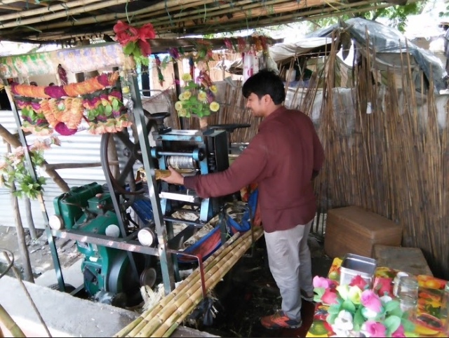 Roopchand runs a sugarcane juice shop to make ends meet.