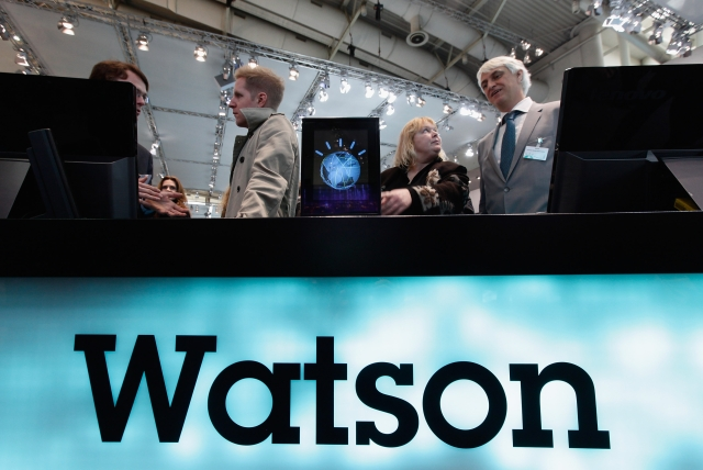 Visitors check out a slimmed down version of the IBM Watson supercomputer. (Photo: Sean Gallup/Getty Images)