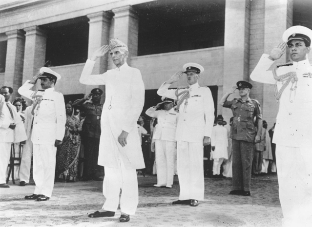 Jinnah taking the salute at a military march past in Karachi, having been sworn in as the first governor general of the Muslim Dominion of Pakistan. (Keystone/GettyImages)