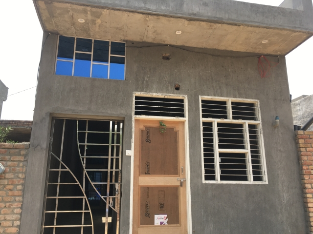 Newly built house (under construction) that belong to Satish, the main accused.