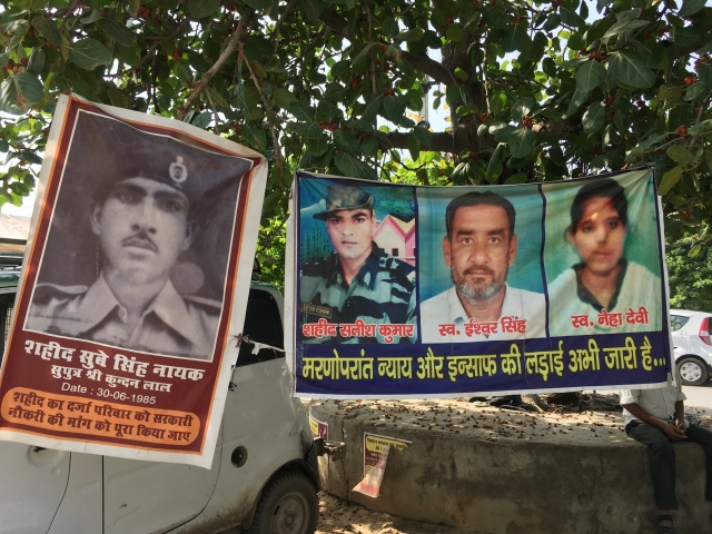 Posters at the site of protest