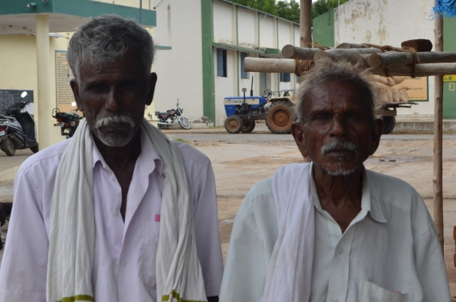 Farmers Kuppan and Gopal (right) relax at Ammoor regulated market after having sold their produce through eNAM.