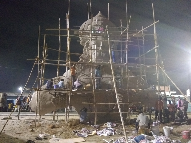 Work in full swing at night to make PoP statue of Lord Hanuman